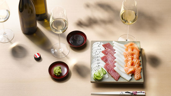 the picture shows Sashimi and white wine